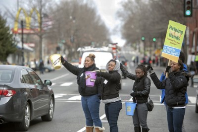 Hundreds of students lined Georgia Avenue between Barry Place and W Street asking for donations so they can help others in seven cities and Haiti during spring break. /Photo Courtesy Howard University