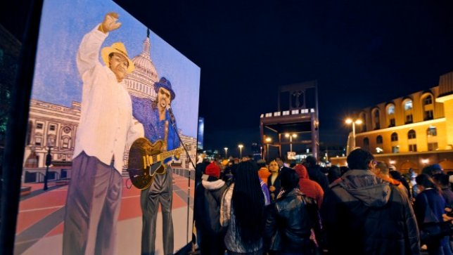 Oliver Johnson, Jr., holds an acrylic painting he did of former Mayor Marion Barry and Chuck Brown, during a vigil to honor former Mayor and current DC City Council member Marion Barry, Sunday, Nov. 23, 2014, in Washington